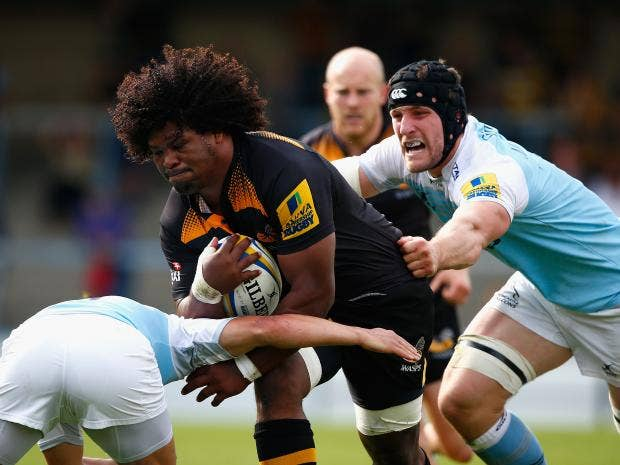 Ashley-Johnson-of-Wasps-is-tackled-by-Mark-Wilson-of-Newcastle.jpg