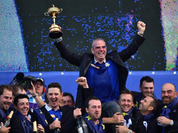 Captain-of-Team-Europe-Paul-McGinley-of-Ireland-holds-the-trophy-after-Team-Europe-retained-the-Ryder-Cup.jpg