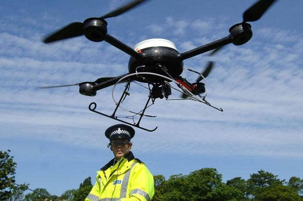 PC Derek Charlton Of Merseyside Police Operates Their New Aerial Surveillance Drone In Liverpool John Giles PA Wire
