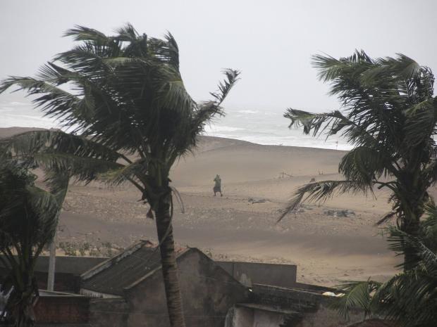 ManWalksCyclone.jpg