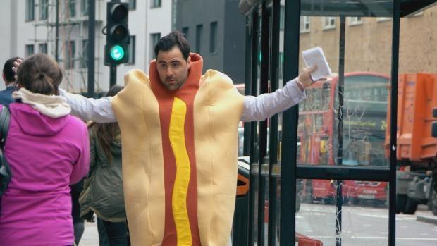 Daniel Waving in Hotdog Suit - Embargoed to 00.01 14th October 2014.jpg