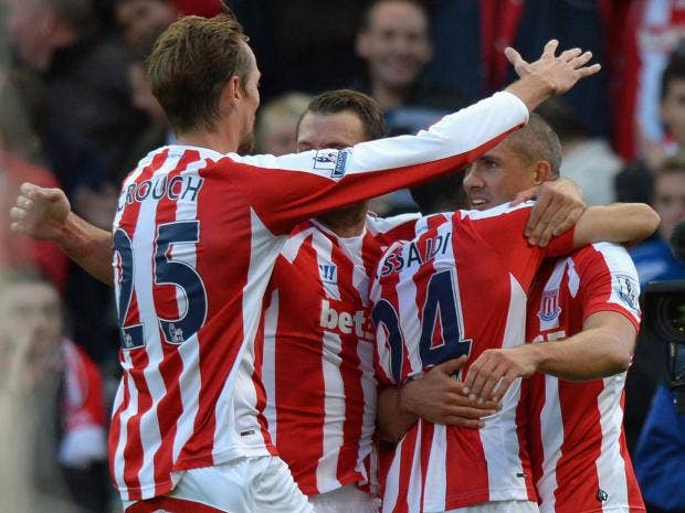 Jonathan-Walters-of-Stoke-City-(R)-is-congratulated-by-team-mates-on-scoring-their-second-goal-d.jpg