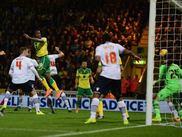 Cameron-Jerome-scores-a-goal-for-Norwich-City-during-the-Sky-Bet-Championship-match-between-Norwich-City-and-Bolton-Wanderers.jpg