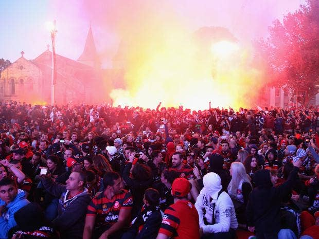 Wanderers-fans-light-flares-as-they-watch-the-Asian-Champions-League-final-match-between-Western-Sydney-Wanders-and-Al-Hilal-at-Centenary-Square-in-Parramatta.jpg