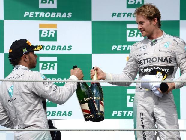 Mercedes-AMG-Petronas-German-driver-Nico-Rosberg-(R)-celebrates-on-the-podium-with-teammate-Lewis-Hamilton.jpg