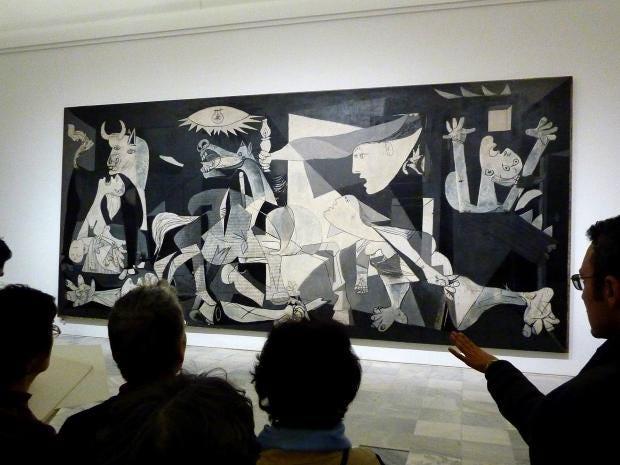 People_looking_at_Guernica_painting.jpg