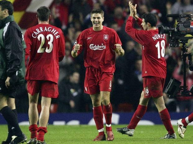 Steven-Gerrard-of-Liverpool-celebrates-victory-over-Olympiakos-with-Jamie-Carragher.jpg