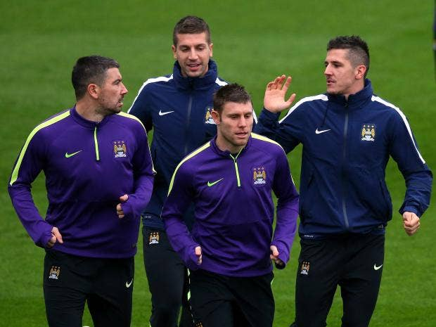 Aleksandar-Kolarov,-Stevan-Jovetic,James-Milner-and-Matija-Nastasic-of-Manchester-City-warm-up.jpg