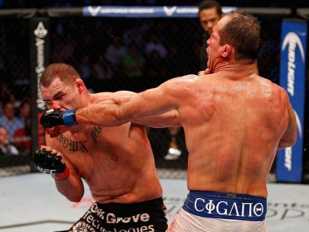 Junior-Dos-Santos-and-Cain-Velasquez-exchange-punches---Josh-Hedges-Zuffa-LLC.jpg