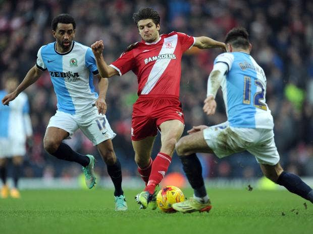 Lee-Williamson--and-Ben-Marshall-of-Blackburn-Rovers-tackle-George-Friend-of-Middlesbrough.jpg