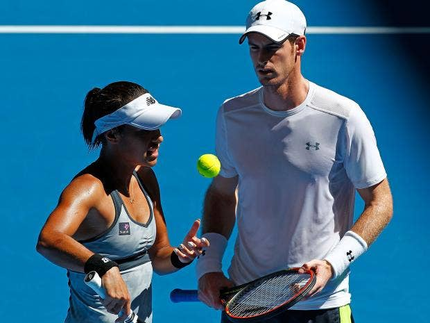 Heather-Watson-and-Andy-Murray-of-Great-Britain-talk-in-between-serves-in-the-mixed-doubles-match-against-Jerzy-Janowicz-and-Agnieszka-Radwansk.jpg
