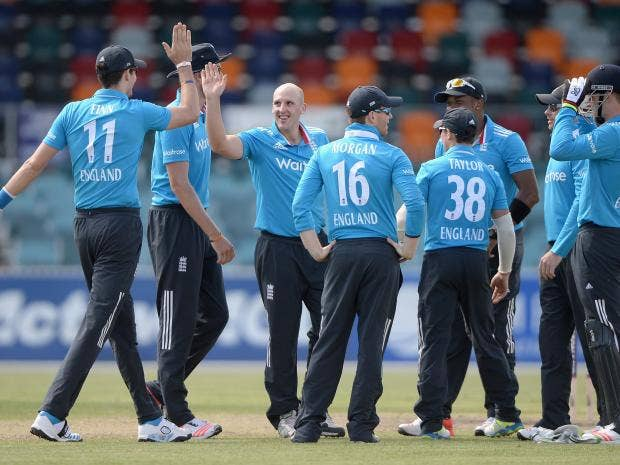 James-Tredwell-of-England-celebrates-with-teammates-after-dismissing-Vele-Dukoski-of-ACT-XI.jpg