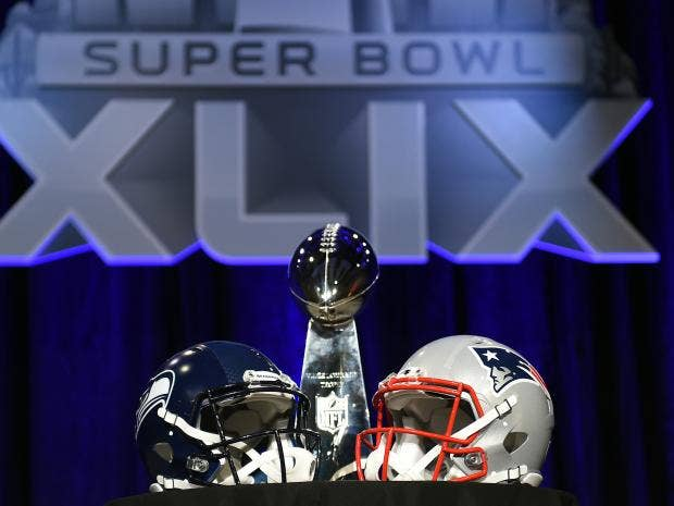 The-Vince-Lombardi-Trophy-sits-alongside-the-helmets-of-the-Seattle-Seahawks-and-New-England-Patriots.jpg