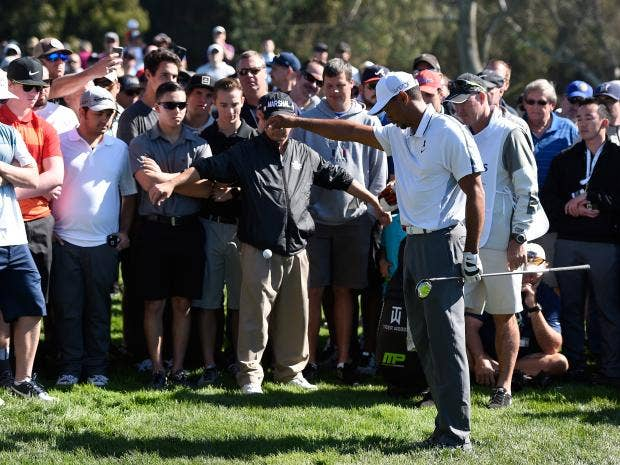 Tiger-Woods-takes-a-drop-in-the-rough-on-the-11th-hole-of-the-north-course-during-the-first-round-of-the-Farmers-Insurance-Open-at-Torrey-Pines.jpg