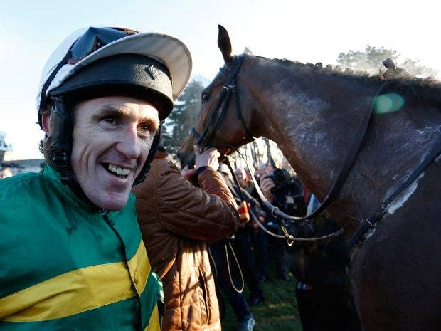 Tony-McCoy-riding-Carlingford-Lough-return-after-winning-The-Hennessey-Gold-Cup-at-Leopardstown-racecourse.jpg