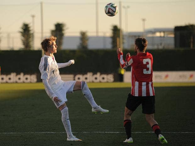 Martin-Odegaard-of-Real-Madrid-Castilla-in-action-against-Egoitz-Magdaleno.jpg
