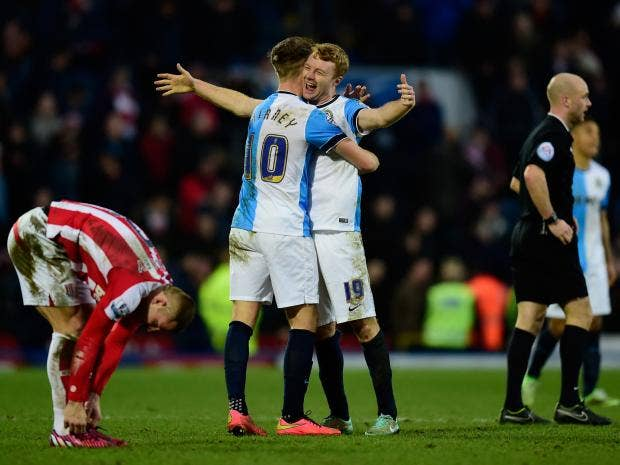 Blackburn-players-Tom-Cairney-(l)-and-Chris-Taylor-celebrate-after-the-FA-Cup-Fifth-round.jpg