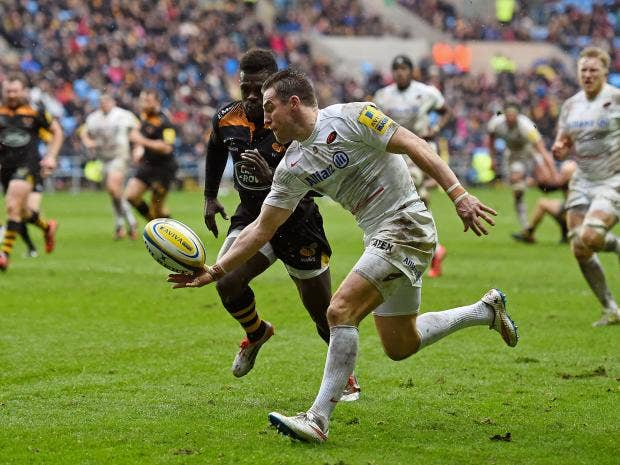 Chris-Wyles-of-Saracens-gathers-the-loose-ball-ahead-of-Christian-Wade-of-Wasps-en-route-to-scoring-his-team's-second-try.jpg