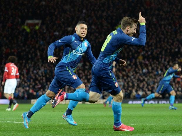 Nacho-Monreal-celebrates-scoring-the-opening-goal-with-Arsenals-English-midfielder-Alex-Oxlade-Chamberlain.jpg
