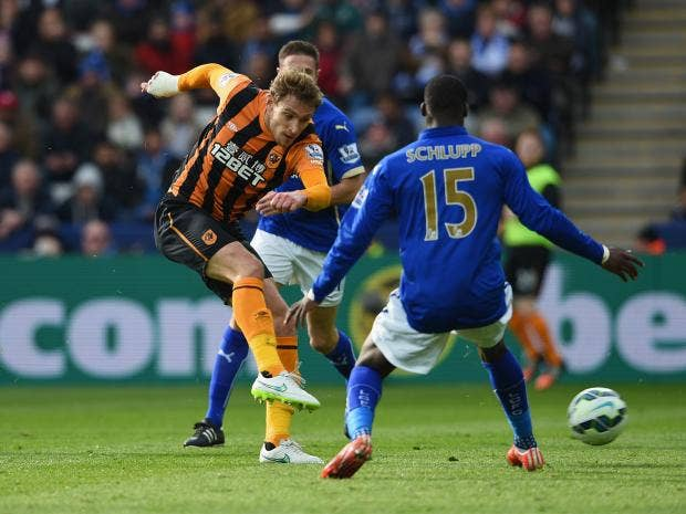 Nikica-Jelevic-of-Hull-City-shoots-past-Jeffrey-Schlupp.jpg