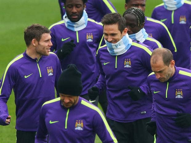 James-Milner-and-Frank-Lampard-in-discussion-as-they-jog-with-team-mates-during-a-Manchester-City-training-session.jpg