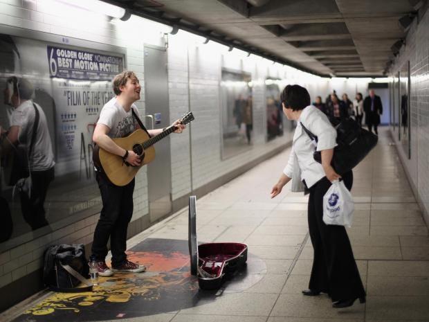 busking.underground.subway.guitarjpg