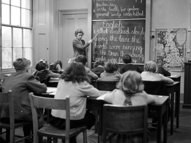 13-Teacher-Blackboard-getty_1.jpg