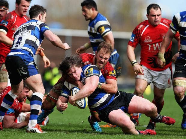 Nick-Auterac-of-Bath-is-tackled-by-Lachlan-McCaffrey-of-London-Welsh.jpg