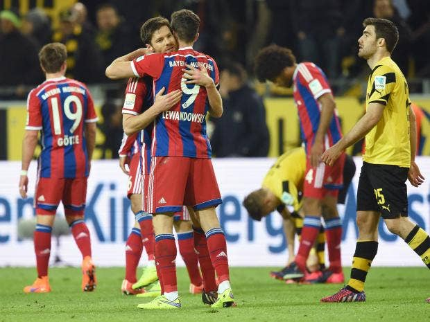 Xabi-Alonso-of-Muenchen-and-Robert-Lewandowski-of-Muenchen-celebrate-after-the-Bundesliga-match-between-Borussia-Dortmund.jpg