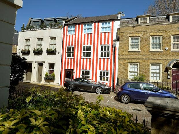 Red and white striped house in kensington to be re painted for Tech house london