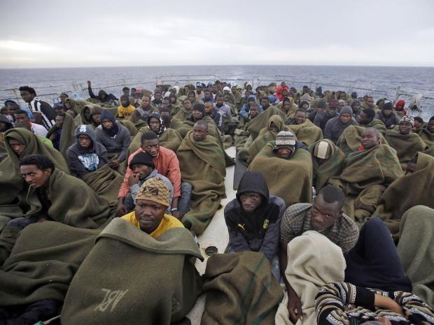 pg-4-migrants-1-ap.jpg