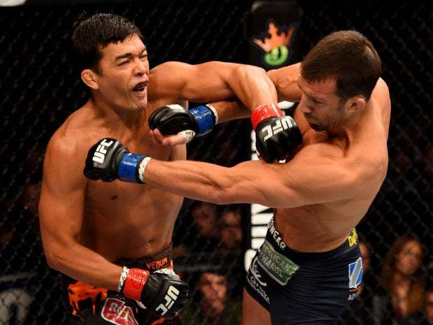 Lyoto-Machida-punches-Luke-Rockhold---picture-credit-=-JOSH-HEDGES-AND-ZUFFA-LLC.jpg