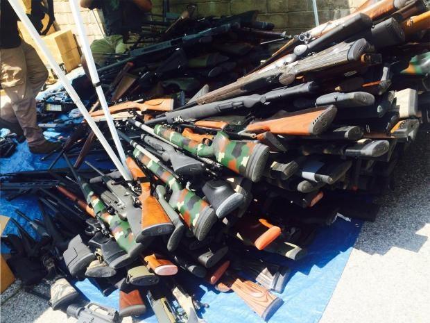 pg-24-cia-guns-1-epa.jpg