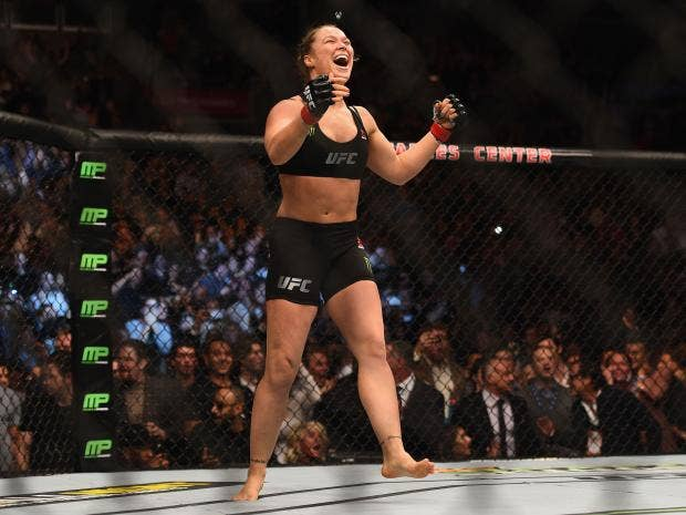 Ronda-Rousey-celebrates-Zingano-win---photo-credit--JEFF-BOTTARI-AND-ZU---.jpg