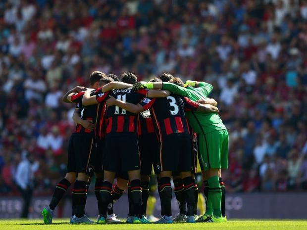 Bournemouth-players-form-a-huddle-prior-to.jpg