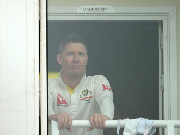 Michael-Clarke-of-Australia-looks-on-from-the-change-rooms-after-rain-stopped-play-during-day-four.jpg