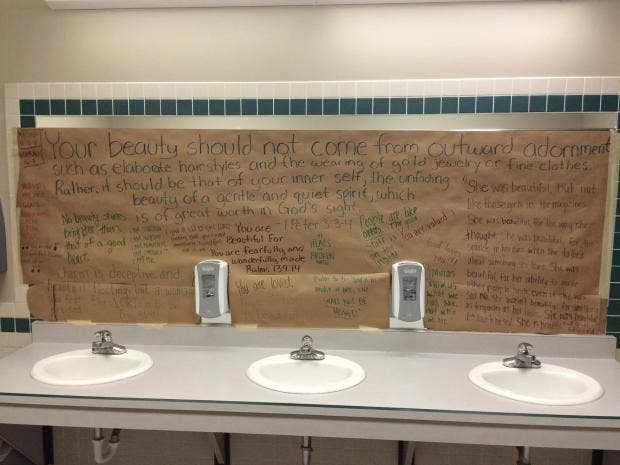 high school bathroom. kansas high school students cover bathroom mirrors with inspirational messages to promote positive body image