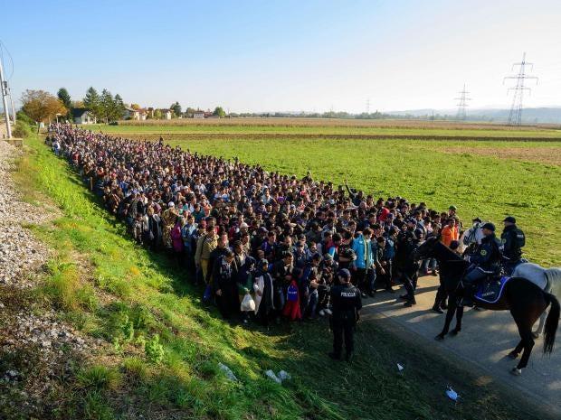 37-Police-escort-migrants-AFP-Getty.jpg