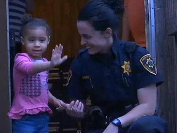 Police-woman-with-child.jpg