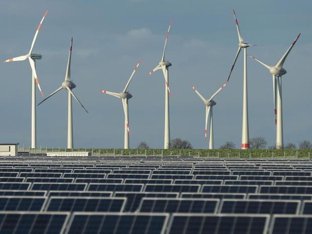 Wind turbines near a solar power plant in Werder, Germany Sean Gallup/Getty  Images