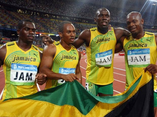 L R Nesta Carter Michael Frater Usain Bolt And Asafa Powell Celebrate Jamaicas 4x100m Relay Victory In 2008 Getty