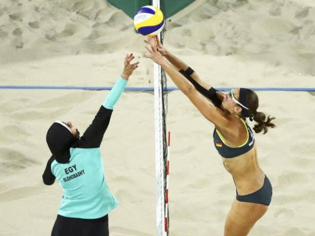 I don't know whether to be more offended by volleyball players covered in a  burkini or exposed in bikini