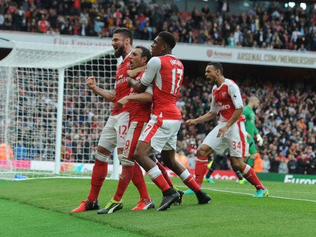 arsenal celebrate santi cazorla s late winner against southampton getty images