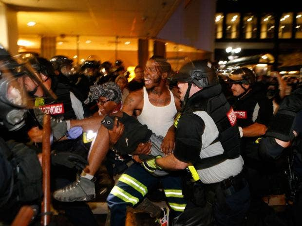 Charlotte workers asked to stay home after night of violence