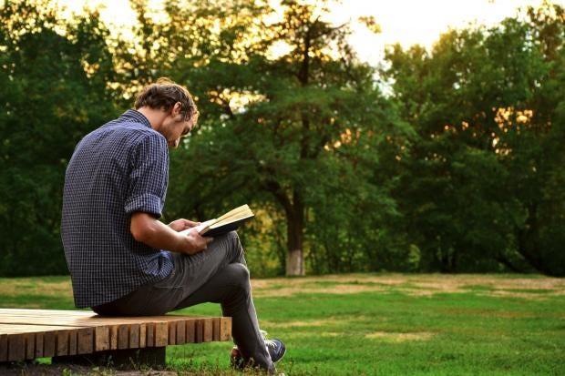 man-reading-book-outside.jpg