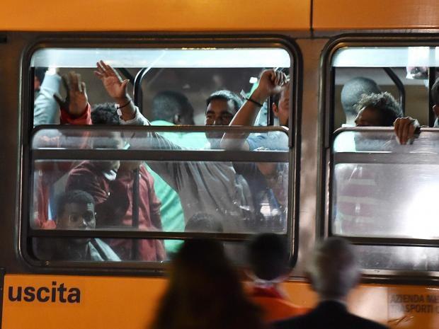 italy-bus-refugees.jpg