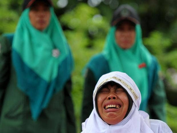woman-caned-indonesia-getty.jpg