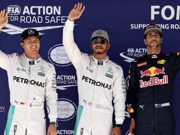 Hamilton beats title rival Rosberg to pole