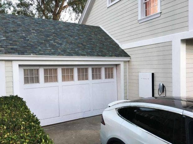 elon musk unveils solar panels resembling traditional roofing tiles the independent