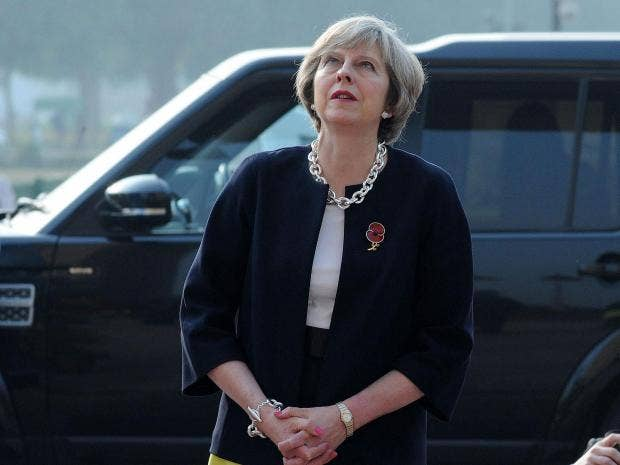 May says UK will champion free trade in changing world